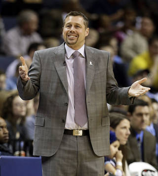 Memphis Grizzlies head coach Dave Joerger reacts to a call that went against his team in the first half of an NBA basketball game against the Portland Trail Blazers on Tuesday, March 11, 2014, in Memphis, Tenn. (AP Photo/Mark Humphrey)