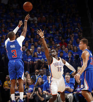 Los Angeles' Chris Paul (3) shoots against Oklahoma City's Reggie Jackson (15) next to Los Angeles' Blake Griffin (32) during Game 1 of the Western Conference semifinals in the NBA playoffs between the Oklahoma City Thunder and the Los Angeles Clippers at Chesapeake Energy Arena in Oklahoma City, Monday, May 5, 2014. Photo by Sarah Phipps, The Oklahoman
