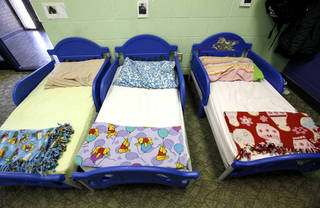 The Pauline E. Mayer children's shelter in Oklahoma City continues to operate at near capacity, prompting DHS officials to obtain a license for a second Oklahoma City shelter. This photograph of tiny beds was taken at the Pauline E. Mayer shelter last January. JIM BECKEL - THE OKLAHOMAN