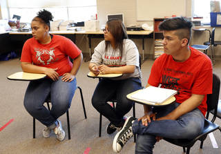 From left, Yessica Wiggins, Cristall Borrego and Luis Barajas take part in a discussion during a gay-straight student group meeting at U.S. Grant High School. PHOTO BY SARAH PHIPPS, THE OKLAHOMAN