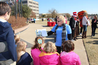 """Saundra Arnold, author of """"My Friend Isaac,"""" reads to a group of children Friday at the state Capitol during the ReadOK event sponsored by the state Education Department. PHOTO PROVIDED"""