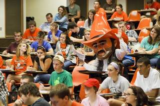 Pistol Pete raises his hand in favor of OSU's block tuition, recently approved by OSU-A&M Regents. Image from University Marketing/Oklahoma State University