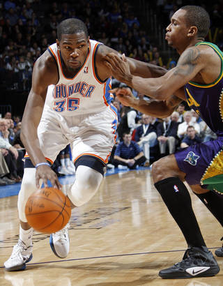 Oklahoma City's Kevin Durant (35) drives the ball past New Orleans' Lance Thomas (42) during an NBA basketball game between the Oklahoma City Thunder and the New Orleans Hornets at the Chesapeake Energy Arena in Oklahoma City, Monday, Feb. 20, 2012. Oklahoma City won, 101-93. Photo by Nate Billings, The Oklahoman
