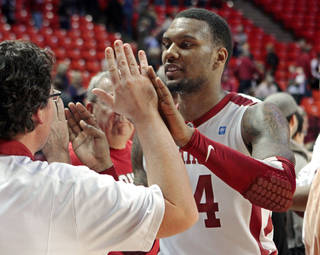 Oklahoma Sooners' Romero Osby (24) celebrates with fans as the University of Oklahoma (OU) Sooners defeat the Kansas State Wildcats 82-73 in men's college basketball at the Lloyd Noble Center on Saturday, Jan. 14, 2012, in Norman, Okla. Photo by Steve Sisney, The Oklahoman