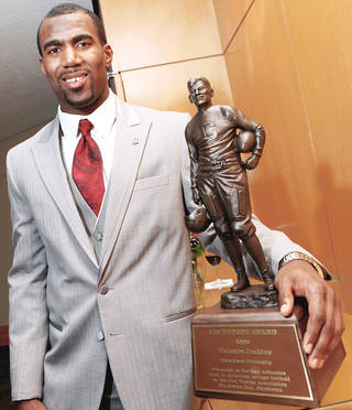 Above: Malcolm Jenkins poses with the Jim Thorpe Award after accepting the trophy on Monday. Photo By John Clanton, The Oklahoman