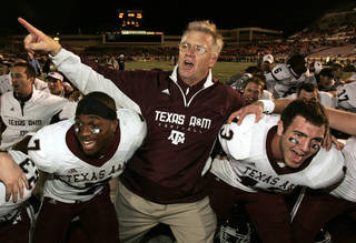 CELEBRATION: Texas A&M University head coach Mike Sherman celebrates with players Uzoma Nwachukwu (7) and Aaron Arterburn (43) and the rest of the team after an NCAA college football game against Texas Tech University in Lubbock, Texas, Saturday, Oct. 24, 2009. Texas A&M won 52 - 30. (AP Photo/Mike Fuentes) ORG XMIT: TXMF111
