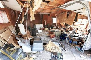 A house on College Ave. shows tornado storm damage in Guthrie, June 7 2011. Photo by Ashley West, The Oklahoman ORG XMIT: KOD