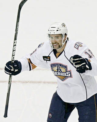 OKLAHOMA CITY BARONS: Oklahoma City's Colin McDonald celebrates after scoring the Barons' first goal against Milwaukee during their AHL hockey game at the Cox Convention Center in Oklahoma City on Sunday, Nov. 21, 2010. Photo by John Clanton, The Oklahoman ORG XMIT: KOD