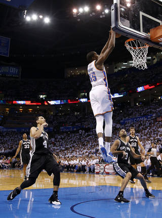 Oklahoma City's Kevin Durant (35) dunks in between San Antonio's Danny Green (4), Tony Parker (9) and Tiago Splitter (22) during Game 6 of the Western Conference Finals in the NBA playoffs between the Oklahoma City Thunder and the San Antonio Spurs at Chesapeake Energy Arena in Oklahoma City, Saturday, May 31, 2014. Photo by Bryan Terry, The Oklahoman