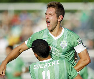 Energy FC midfielder Michael Thomas (8) jumps on teammate Adda Djeziri (11) to celebrate scoring a goal during a USL Pro soccer game between OKC Energy FC and Pittsburgh Riverhounds FC at Pribil Stadium in Oklahoma City on July 12, 2014. Photo by KT King/The Oklahoman