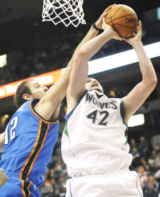 Thunder center Nenad Krstic, left, fouls Minnesota's Kevin Love during Oklahoma City's 109-107 victory on Sunday night in Minneapolis. AP PHOTO