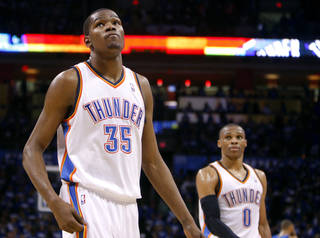 Oklahoma City's Kevin Durant (35) and Russell Westbrook (0) leave the court following game 3 of the Western Conference Finals of the NBA basketball playoffs between the Dallas Mavericks and the Oklahoma City Thunder at the OKC Arena in downtown Oklahoma City, Saturday, May 21, 2011. Photo by Sarah Phipps, The Oklahoman