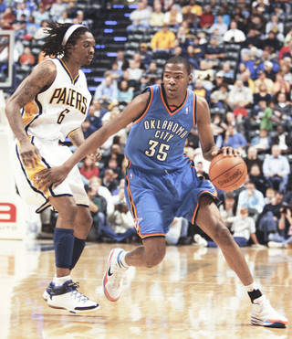 The Thunder's Kevin Durant, right, drives past Pacers guard Marquis Daniels during action Monday in Indinanpolis. Durant scored 37 points in the loss.AP photo