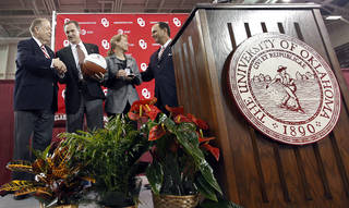 University of Oklahoma president David Boren shakes hands with new men's basketball coach Lon Kruger while athletic director Joe Castiglione speaks to Barbara Kruger during an event to introduce Lon Kruger as the new University of Oklahoma men's basketball coach on Monday, April 4, 2011, in Norman, Okla. Photo by Chris Landsberger, The Oklahoman