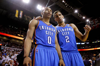 Oklahoma City's Russell Westbrook (0) and Thabo Sefolosha (2) talk during Game 4 of the NBA Finals between the Oklahoma City Thunder and the Miami Heat at American Airlines Arena, Tuesday, June 19, 2012. Photo by Bryan Terry, The Oklahoman