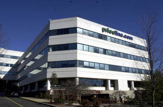 Priceline.com headquarters is seen in Norwalk, Conn. Priceline is buying online restaurant reservation company OpenTable for $2.6 billion. AP File Photo Douglas Healey -