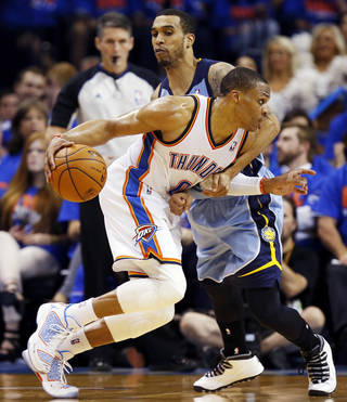 Oklahoma City's Russell Westbrook (0) is fouled by Memphis' Courtney Lee (5) during Game 7 in the first round of the NBA playoffs between the Oklahoma City Thunder and the Memphis Grizzlies at Chesapeake Energy Arena in Oklahoma City, Saturday, May 3, 2014. The Thunder won 120-109. Photo by Nate Billings, The Oklahoman