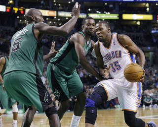 Oklahoma City Thunder forward Kevin Durant (35) drives against Boston Celtics forwards Kevin Garnett (5) and Jeff Green during the second half of an NBA basketball game in Boston, Friday, Nov. 23, 2012. The Celtics won 108-100. (AP Photo/Elise Amendola) ORG XMIT: MAEA114