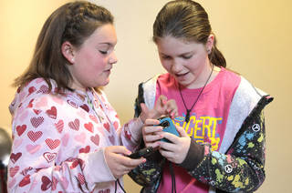 Girl Scout Juniors Jamie Wilson and Rachel Porter, of Troop 234, learn digital photography at the Oklahoma City University Intergenerational Computer Center. Photo By David McDaniel, The Oklahoman David McDaniel - The Oklahoman