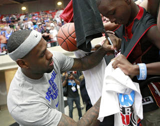 LeBron James signs a jersey for D.J. Sims, of Lawton, Okla., during the US Fleet Tracking Basketball Invitational at the Cox Convention Center in Oklahoma City Sunday, Oct. 23, 2011. Photo by John Clanton, The Oklahoman ORG XMIT: KOD