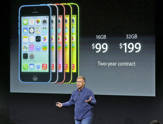 Phil Schiller, Apple's senior vice president of worldwide product marketing, speaks on stage during the introduction of the new iPhone 5c in Cupertino, Calif., Tuesday, Sept. 10, 2013. (AP Photo/Marcio Jose Sanchez) ORG XMIT: FX117