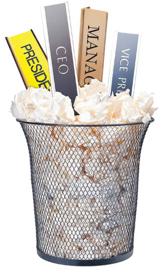 Side view of wastepaper basket filled with crumpled paper