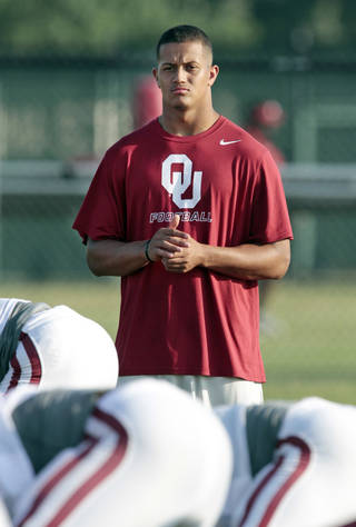 Linebacker Jordan Evans is sidelined during the University of Oklahoma Sooners (OU) football practice at the rugby fields in Norman, Okla., on Tuesday, Aug. 5, 2014. Photo by Steve Sisney, The Oklahoman