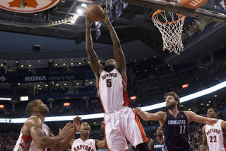 Toronto Raptors' Amir Johnson (5) claims a defensive rebound in front of Charlotte Bobcats Josh McRoberts, second from right, during second-half NBA basketball game action in Toronto, Friday, March 15 , 2013. (AP Photo/Canadian Press, Chris Young) ORG XMIT: CHY117