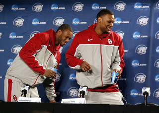 Oklahoma's Amath M'Baye (22), left, and Oklahoma's Romero Osby (24) smiles as they leave the interview room during the practice and press conference day for the second round of the NCAA men's college basketball tournament at the Wells Fargo Center in Philadelphia, Thursday, March 21, 2013. As they left, Osby asked the moderator if he could take his name card with him and was told they would get it to him after it was done being used. OU will play San Diego State in the second round on Friday. Photo by Nate Billings, The Oklahoman