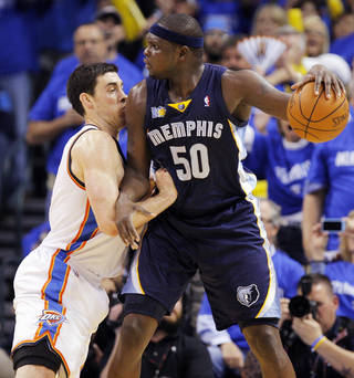 Zach Randolph (50) of Memphis looks over Nick Collison (4) of Oklahoma City in the first half during game one of the Western Conference semifinals between the Memphis Grizzlies and the Oklahoma City Thunder in the NBA basketball playoffs at Oklahoma City Arena in Oklahoma City, Sunday, May 1, 2011. Photo by Nate Billings, The Oklahoman ORG XMIT: KOD