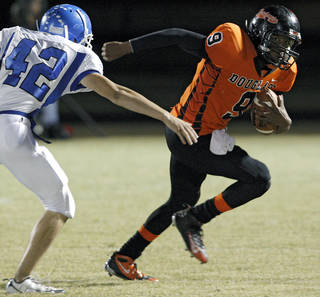 Glenpool's Cody Davis tries to catch Douglass' Marcus Caddell during their game at Moses F. Miller Stadium at Douglass High School in Oklahoma City on Friday, Oct. 29, 2010. Photo by John Clanton, The Oklahoman