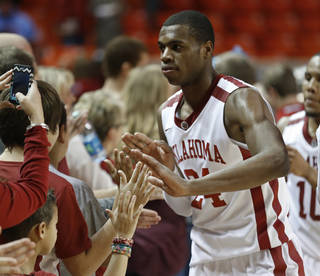 Oklahoma Sooner's Buddy Hield (24) greets fans after the buzzer as the University of Oklahoma Sooners (OU) men defeat the Iowa State Cyclones (ISU) 87-82 in NCAA, college basketball at The Lloyd Noble Center on Saturday, Jan. 11, 2014 in Norman, Okla. Photo by Steve Sisney, The Oklahoman