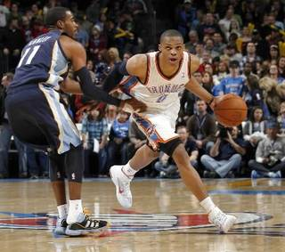 Oklahoma City's Russell Westbrook (0) drives up court as Mike Conley (11) defends during the NBA basketball game between the Oklahoma City Thunder and the Memphis Grizzlies, Saturday, Jan. 8, 2011, at the Oklahoma City Arena. Photo by Sarah Phipps, The Oklahoman