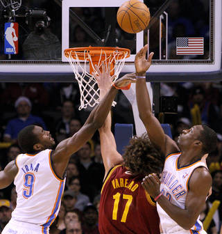Serge Ibaka and Jeff Green pressure a shot by Cleveland's Anderson Varejao. Photo by John Clanton, The Oklahoman