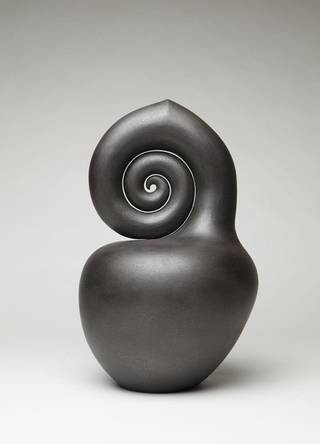 """Nautilus,"" a sculpture by Navao artist Christine Nofchissey McHorse, is one of the works on display in ""Dark Light"" at the Fred Jones Jr. Museum of Art in Norman. PHOTO PROVIDED. Photographer: Addison Doty"