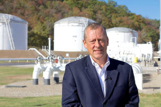 Magellan Midstream Partners CEO Mike Mears stands in front of gasoline and diesel storage tanks at the company's Tulsa terminal. Adam Wilmoth - photo by
