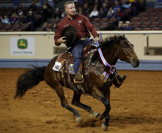 Corey Cushing, of Scottsdale, Ariz., rides in on Rising Starlight, the 2012 AQHA Superhorse, during the American Quarter Horse championship at the Oklahoma State Fair Park in Oklahoma City, Saturday, Nov. 17, 2012. Photo by Garett Fisbeck, The Oklahoman