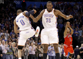 Oklahoma City's Russell Westbrook and Kevin Durant celebrate during the NBA basketball game between the Oklahoma City Thunder and the Chicago Bulls in the Oklahoma City Arena on Wednesday, Oct. 27, 2010. Photo by Bryan Terry, The Oklahoman