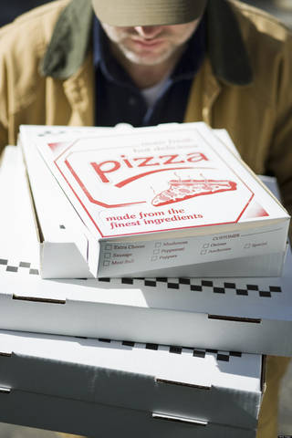 Several pizzas being delivered