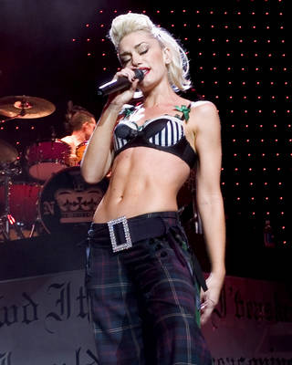 "** FILE ** SINGER: Gwen Stefani performs with the band No Doubt at the Tweeter Center in Mansfield, Mass., in this June 8, 2004, file photo. The No Doubt front woman has left her Madness loving band mates behind for more Lisa Lisa inspired fare on her first solo CD, ""Love, Angel, Music, Baby."" (AP Photo/Robert E. Klein/FILE)"