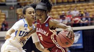 Oklahoma's Aaryn Ellenberg brings the ball up court as UCLA's Mariah Williams defends during the Sooners' NCAA tournament victory over the Bruins, 85-72. (Jay LaPrete / Associated Press / March 25, 2013)