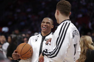 West Team's Russell Westbrook of the Oklahoma City Thunder and Blake Griffin of the Los Angeles Clippers talk before the NBA All-Star basketball game Sunday, Feb. 17, 2013, in Houston. (AP Photo/Eric Gay) ORG XMIT: HTR115