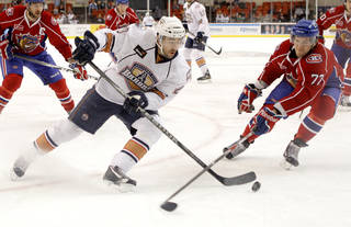 Oklahoma City's Brad Moran tries to get past Hamilton's Mathieu Carle during a first round game of the AHL hockey playoffs between the Hamilton Bulldogs and the Oklahoma City Barons at the Cox Convention Center on Wednesday, April 20, 2011. Photo by Bryan Terry, The Oklahoman ORG XMIT: KOD
