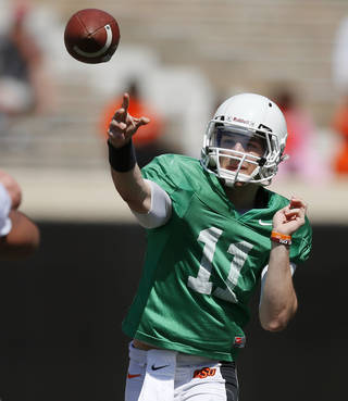 OSU's Jake Hubenak throws a pass during Oklahoma State's Orange Blitz football practice at Boone Pickens Stadium in Stillwater, Okla., Saturday, April 5, 2014.