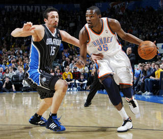 Oklahoma City's Kevin Durant (35) drives the ball past Hedo Turkoglu (15) of Orlando during the NBA basketball game between the Orlando Magic and Oklahoma City Thunder in Oklahoma City, Thursday, January 13, 2011. Photo by Nate Billings, The Oklahoman