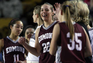 Edmond Memorial's Alie Decker (22) smiles in the final moments of their game against Sapulpa, at the Mabee Center, on Friday, Mar. 9, 2012. CORY YOUNG/Tulsa World ORG XMIT: DTI1203092145168224