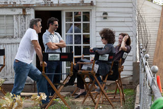 "This image released by The Weinstein Company shows, from left, producers George Clooney, Grant Heslov, and actresses Meryl Streep, and Julianne Nicholson on the set of ""August: Osage County."" Streep was nominated for a Golden Globe for best actress in a motion picture musical or comedy for her role in the film. (AP Photo/The Weinstein Company, Claire Folger)"