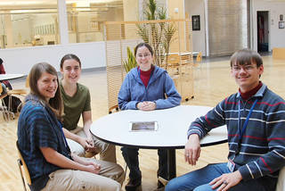 University of Oklahoma College of Engineering professor Amy McGovern, center, and students Andrea Balfour, left, Marissa Beene and David Harrison created Storm Evader, a gaming app that helps kids understand weather patterns. PHOTO PROVIDED PROVIDED - Photo Provided