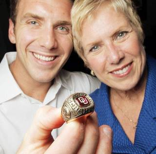 Ben Barresi holds his late father's 1973 OU Big Eight Championship ring as he and his mother, Janet Barresi, pose for a photo in the Oliver Hodge Building at the state Capitol in Oklahoma City, Friday, July 22, 2011. John Barresi's 1973 Big Eight Championship ring, which was stolen 17 years ago, was recently recovered by State Trooper Jason McAlister. Photo by Nate Billings, The Oklahoman ORG XMIT: KOD