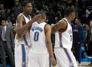 Oklahoma City's Kevin Durant, Russell Westbrook and Desmond Mason react after losing the Cleveland Cavaliers, Sunday, Dec. 21, 2008, at the Ford Center in Oklahoma City. PHOTO BY SARAH PHIPPS